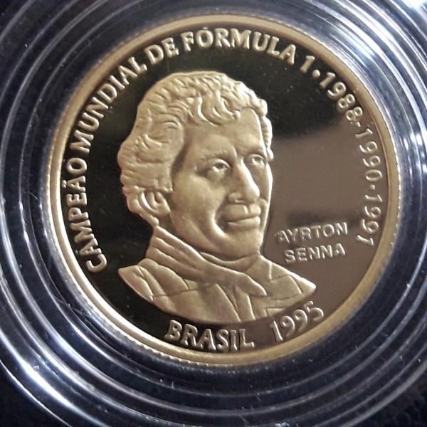 3 - Moeda OURO Brasil COMEMORATIVA DO AYRTON SENNA 20 Reais de 1994. Peça escassa Peso 8gr.