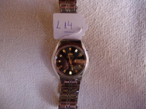 a0518c61ed2 Relógio Orient antigo japonês bem conservado. Funcionando. Pulseira  original. Pequenos riscos de uso. Mostrador preto e dourado.