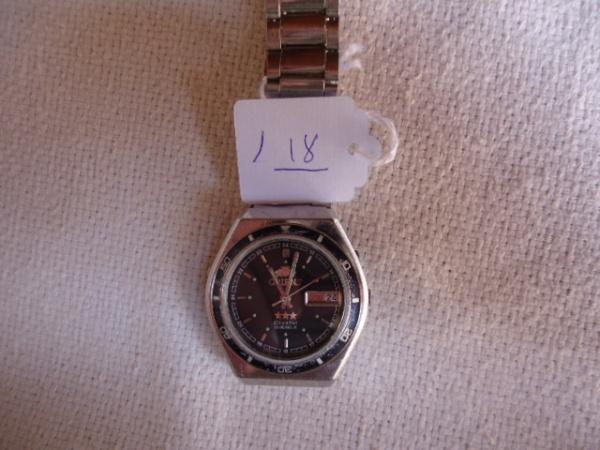87aae6b0b91 Relógio Orient Antigo automático modelo diferenciado. Funcionando.  Conservação razoável. Mostrador preto e sem detalhes. Bem riscado.