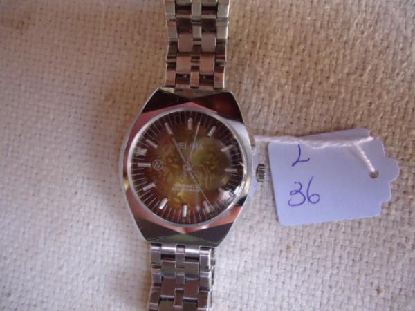 c68d998cbad Relógio antigo a corda marca NELIMA