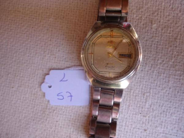 1b9086e8cb1 Relógio Orient Antigo automático com o vidro riscado.funcionando.