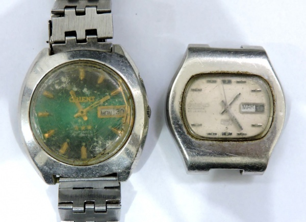 492422ca858 Lote contendo 2 relógios masculinos sendo 1 da marca Orient e outro da  marca Seiko