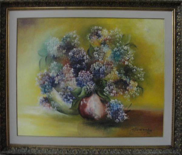 M. L. COLOMBO, óleo sobre tela, representando vaso com flores, medindo 80 x 64 cm.