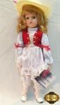 Boneca Heidi em porcelana da coleção The Heritage Mint ltd, na embalagem original. Medindo 40cm de altura