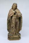 SAGRADO CORAÇÃO DE JESUS - Imagem esculpida em madeira policromada, Brasil - Século XIX. Rico movimento no manto, resquícios de policromia. Faltando as mãos. Alt.: 28 cm.
