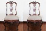 Par de cadeiras em madeira nobre, no estilo  D. José - Séc. XIX. Encosto fenestrado, com raso entralhe de arabesco e flor de lis. Pernas curvas com travessão, saia e pés com entalhes. Assentos forrados em tecido . Acompanha almofada. Medidas: 107 X 58 X 43 cm.