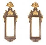 Par de espelhos com moldura em madeira entalhada com plumagens e folhas de acanto, no estilo D. José. Medidas: 68 X 25 cm.