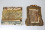 Duas talhas em madeira patinada e com folha de ouro, Minas Gerais. Medidas: 22 X 24 cm e 26 X 22 cm.
