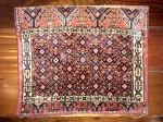 Almofada de tapete persa, medindo: 44 X 53 cm.