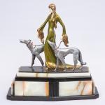 """Otto Poertzel (1876 - 1963) - """"The Aristocrats Borzoi Dogs Figurine """", magnífica escultura inglesa circa 1930, art decô em bronze patinado e marfim apoiada sobre lindíssima base em ônix e mármore negro assinada no bronze, obra reproduzida em catálogo. Med.: 50 x 50 x 18 cm."""