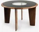 JOAQUIM TENREIRO - Mesa circular com quatro pés em madeira nobre com tampo em vidro pintado em epoxi na cor negra. Med.: 76 x 1,25 cm.