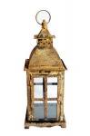 Lanterna tailandesa em ferro trabalhado com efeito envelhecido. Possui vidro nas 4 laterais. Medida total 40cm de altura.