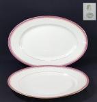 JULES BLOCH & FILS PARIS - LIMOGES - Par de elegantes travessas ovais em porcelana francesa, friso lavanda e dourado. Marcado LIMOGES - FRANCE. Comp. 28 e 34 cm.