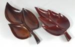 Duas petisqueiras em madeira nobre no formato de folhas, possivelmente JEAN GILLON. Med. 29 e 26 cm.