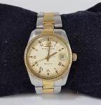 Relógio Baume & Mercier original - BAUMATIC - Automático funcionando. Aço e plaque dor, pulseira original com presilha substituída. Necessita limpeza.