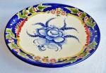 Grande fruteira em porcelana pintada à mão do renomado LUIZ SALVADOR. Medida 37 cm de diâmetro. Peça sem uso , mas possui fios de cabelo.
