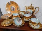 Porcelana  DP,  jarra,  leiteira, manteigueira xícaras de chá sendo decoração casal romântico, e prato de bolo e pratinhos decoração ninfas e  anjo. (desgastes)