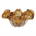 Centro de mesa em vidro de Murano na cor ambâr. Medida 21 cm de diâmetro.
