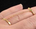 Anel em Ouro 18 K  articulado com Tsavorita com peso total 2,1 gramas.
