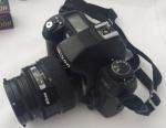 Câmera analógica NIKON modelo F80 LENTE 35-70 mm, com capa, seis caixas com filmes e cinco potes com filmes.
