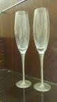 Duas taças de champagne em vidro com pé em metal marcado - Altura:25 cm