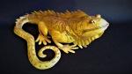 Grande lagarto em metal  com vazados e rico trabalho. peça de origem asiática . Medida 40 cm de comprimento.