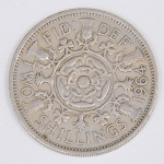 Lote composto por uma moeda do Reino Unido de 2 Shillings cunhada em 1964.