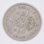 lote composto por uma moeda do Reino Unido de 2 Shillings cunhada em 1949.