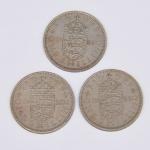 Lote composto por três moedas do Reino Unido de um Shilling cunhadas em respectivamente 1956, 1962, 1965.