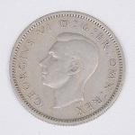 Lote composto por uma moeda do Reino Unido de 6 Pence cunhada em 1948.