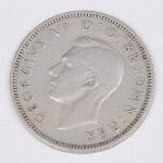 Lote composto por uma moeda do Reino Unido de 1 Shilling cunhada em 1950.
