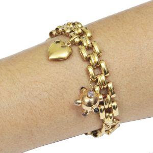 Pulseira em ouro 18 kl com 2 pingentes em ouro(coração e globo), Peso total: 20,8 g. Comp: 20 cm.