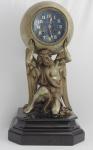 Relogio de mesa em bronce com banho de prata e base de marmore preta. Imagen representando Deus Zeus . Altura 45 cm.