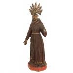 Escultura em madeira policromada representando Santo. Acompanha resplendor em metal. Brasil. Séc XIX. 22,5 cm sem o resplendor e 27,5 cm com o resplendor.