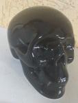 Crânio em louça na cor preta, medindo 8 centímetros de altura - opcionalmente cofre, contemporâneo - sem uso
