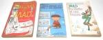 Lote contendo 2 livros da Mad e 1 dos Peanuts / Charlie Brown. Medindo 18cm de altura cada. Obs: marcas do tempo.