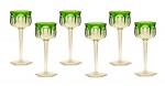 """BACCARAT - Modelo """"Malmaison"""" - Raro conjunto de seis elegantes cálices em cristal francês, bojo abaulado e facetado em overlay incolor sobtonalidade verde esmeralda. França. 19 cm."""