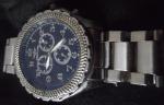Breitling    RÉPLICA.Belíssimo Relógio de pulso modelo masculino cronograph, caixa em aço original, gravado e numerado, mostrador e pulseira pretos, medindo 45 mm de diâmetro, em perfeito estado, funcionando. AUTOMÁTICO