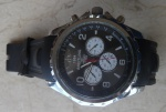 Breitling  RÉPLICA Belíssimo Relógio de pulso modelo masculino cronograph, caixa em aço original, gravado e numerado, mostrador e pulseira pretos, medindo 45 mm de diâmetro, em perfeito estado, funcionando.