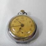 Antigo Relógio de Bolso com ALARME DESPERTADOR, marca CALAN Patent ROSKOFF, mostrador íntegro, funcionando (inclusive o Despertador), e sem garantia futura. Mede aproximadamente 5,2 cm de diâmetro.
