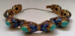 Antiga pulseira em PRATA vermeil Filigranda ricamente trabalhada em detalhes com incrustações de turquesas. Mede: