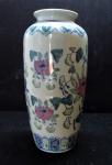 PORCELANA - Vaso floreira policromada com rica decoração floral. Med. 25x10 cm.