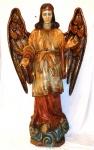 Escultura Brasileira em madeira, representando figura de anjo com fina policromia.        Pedestal em forma de nuvens. Séc. XIX.                                                                                                                     Medidas:  Alt. 185 cm.  x  Larg. 115 cm.