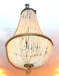 Belíssimo lustre francês no estilo império,                                                                                     bronze e cristais no formato de pera.                                                                                                 Medidas:  Alt. 100 cm  x  Diâm. 65 cm.