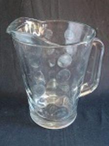 Jarra em grosso vidro moldado lapidado com círculos. Alt. 22cm.