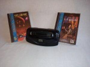 """RETRÔ GAMES - Adaptador para Sistema de console Sega Mega Drive, Mega 32 X , acompanha 2 CDs para console Sega CD dos jogos: """"Stellar-Fire"""" e """"Rise of the Dragon"""". Adaptador usado e sem garantias, cartuchos lacrados na embalagem original."""
