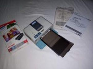 Impressora térmica portátil CP 510. Manufatura Canon, Selphy. Acompanham cartucho e manual. 6,5 x 18 x 13,5cm. Não testada e sem garantias.