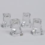 BACCARAT - France -  Conjunto de 4 castiçais de cristal francês, base quadrada, corpo retorcido. Selo da Cristallerie no fundo, 1 com pequeno bicado na base, medida 9 x 5,5 x 5,5 cm. Conforme N.F. da Cristalleries de Baccarat - Paris, datado de 28/06/1950.