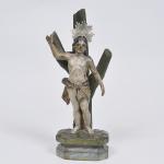 São Sebastião - imagem em madeira policromada com olhos de vidro. Brasil séc. XIX. Medida 37 x 13 x 8 cm. Apresenta resplendor de prata