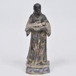 São Benedito - Imagem  em madeira policromada com resquícios de douração séc. XVIII. Medida 33 cm.